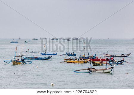 Bali, 6 September 2013:  Colorful handcrafted balinese wooden fishing boats at port in Jimbaran beach, Bali