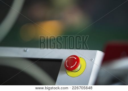 Red Emergency Stop Switch Reset Button On Machinery Industry, Close Up