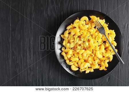 Macaroni And Cheese On Black Plate