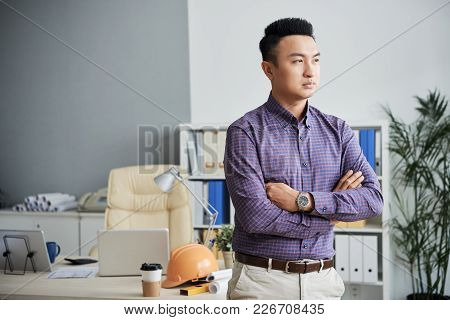 Portrait Of Confident Ambitious Engineer Standing With His Arms Crosses