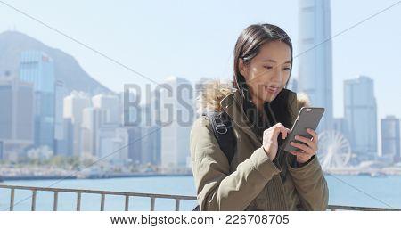 Woman using smart phone in Hong Kong