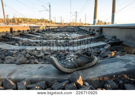 Shoes At The Railway Tracks Of The Sunset Outside The City In Nature
