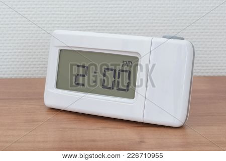 Clock Radio On A Desk - Time - 02.00 Pm