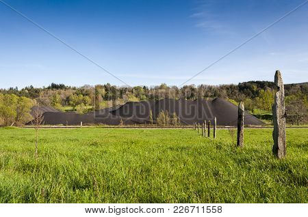 Pile Of Coal In The Mining Area Of The Fenar Valley, La Robla Municipality, In Leon Province, Spain.