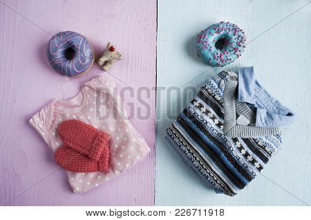 Different Clothes For Newborns With Donuts  Pink And Blue Background
