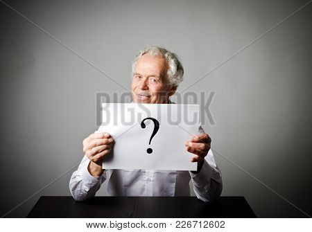Old Man And Question Mark. Old Man In White Having No Answers To A Question.