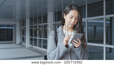 Young Businesswoman using cellphone at outdoor