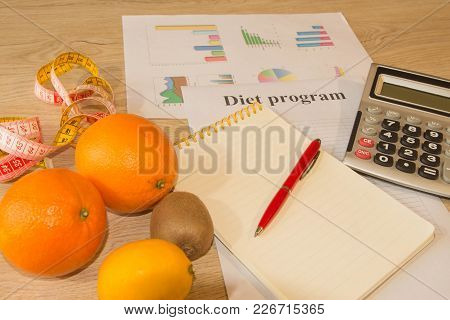 Concept Of Diet. Low-calorie Vegetables Diet. Diet For Weight Loss. Fruits And Vitamins With Measuri