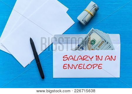 White Envelopes With Money Lie On A Black Wooden Table. Bribe In An Envelope. Salary In An Envelope