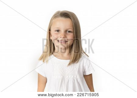 Head Shot Portrait Of Sweet And Beautiful 7 Years Old Young Girl With Blond Hair  Smiling Happy Posi