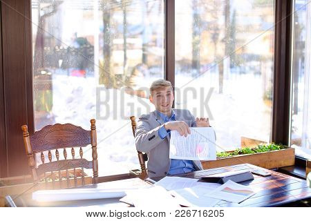 Hardworking Student Preparing Before Exam In Fast Motion At Cafe With Papers And Typing By Tablet In