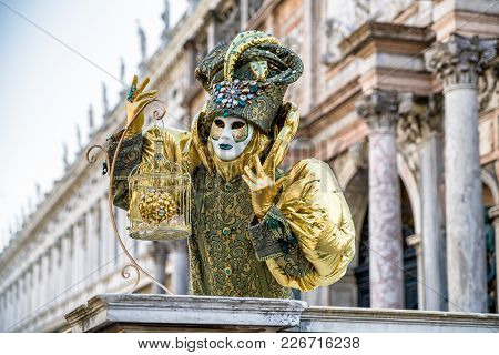 Venice, Italy - February 11: Person In Colorful Mask At Traditional Carnival On February 11, 2018 In