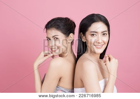 Portrait Of Two Beautiful Asian Woman. Beautiful Woman Looking To Camera.  People With Youth And Ski