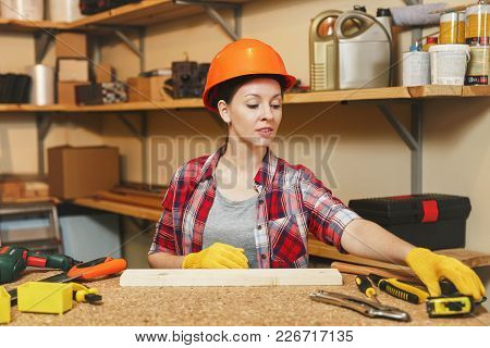 Beautiful Caucasian Young Brown-hair Woman In Plaid Shirt, Gray T-shirt, Yellow Gloves, Protective H