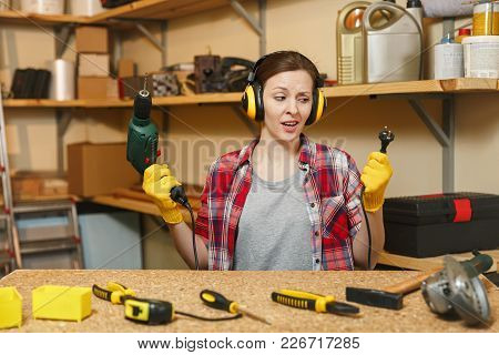 Perplexed Young Woman In Plaid Shirt Gray T-shirt Noise Insulated Headphones Yellow Gloves Working I