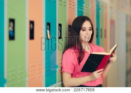 Teacher Holding A Book Standing On A School Corridor