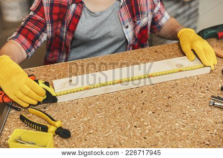 Beautiful Caucasian Young Brown-hair Woman In Plaid Shirt, Gray T-shirt, Yellow Gloves Working In Ca