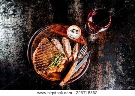 Grilled Beef Steak With Spices On Cutting Board, With And Red Wine Glass. Copy Space Top View