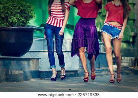 Closeup Photo Of Three Modern Stylish Women Walking On Street