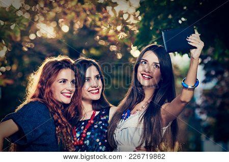 Pretty Happy Women Making Selfie On Tablet During Walk