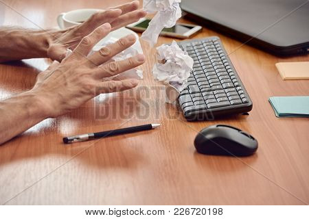 Manager Trying To Find Ideas For Project But Tearing And Crumpling Paper