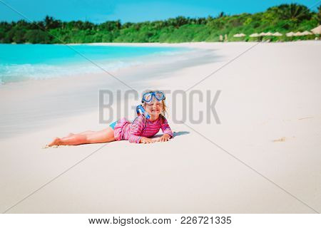Cute Little Girl Snorkeling On Tropical Beach