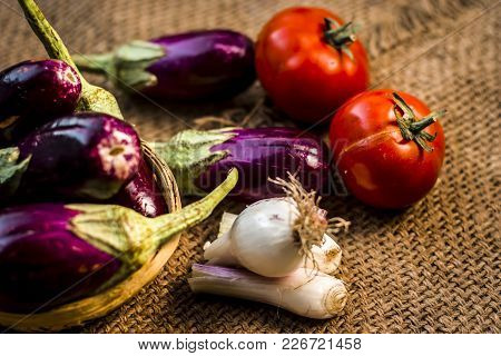 Close Up Of Vegetables For A Spicy Indian Lunch I.e. Egg Plant,solanum Melongena,tomato,solanum Lyco