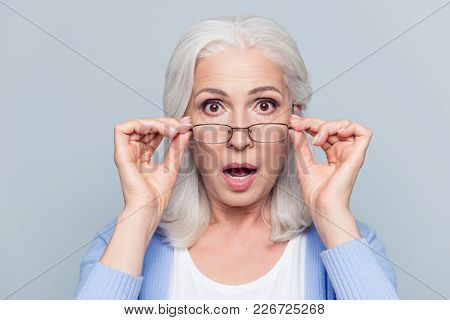 Close Up Portrait Of Stylish, Aged, Charming, Surprised, Shocked Woman Holding Eyelets Peek Out Glas