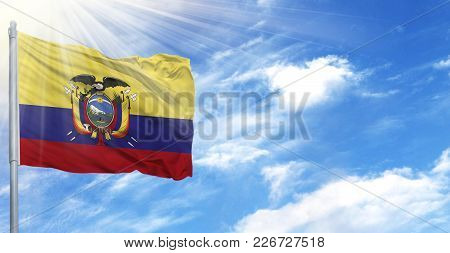 Flag Of Ecuador On Flagpole Against The Blue Sky.