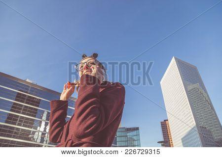 Cute Young Modern Woman Using Cellphone In Urban Surroundings.