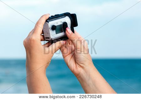 Odessa, Ukraine, September, 2017: Female Hands Shooting Video With Sony Action Cam X3000 On A Seasid