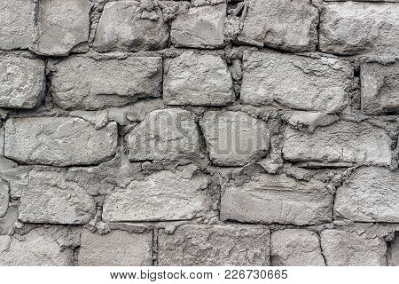 Gray Old Wall Made Of Aerated Concrete Blocks. Texture, Background.