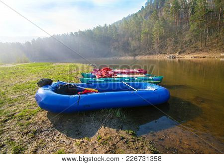 Catamarans And Rubber Boat On River Bank Ai Ural Russia