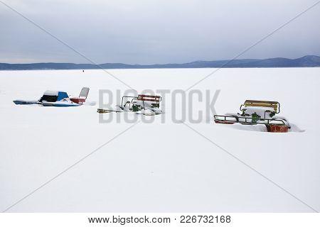 Catamarans In Winter On Snow Coast Of Lake