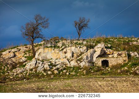 This Image Represent A Old House In The Rock In Sicilian Country