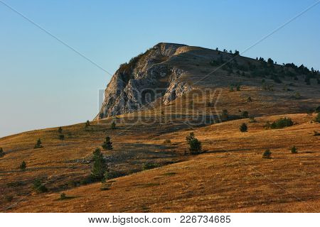 Highlands Of Crimean Mountains. View On A Plateau With A Typical For Such Terrains Karst Formations