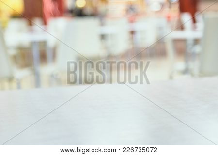 Food Court. Blurred Background. White Light Chairs.