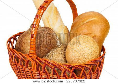 Bread In A Basket. Isolated On White Close Up.