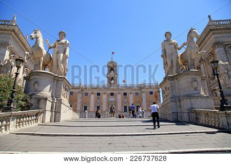 Rome, Italy - July 17, 2017: Tourists On Michelangelo Stairs To Piazza Del Campidoglio On The Top Of