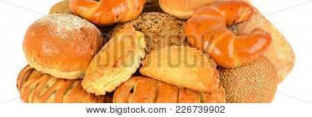 Bread And Bakery Products Isolated On White Background . Wide Photo .