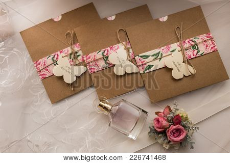 Wedding Invitations In The Craft Envelopes. Wedding Concept. Wedding Accessories. Invitations, Perfu