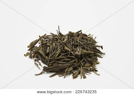 Pile of green tea leaves on a white background - China Qi Shan Mao Jin poster