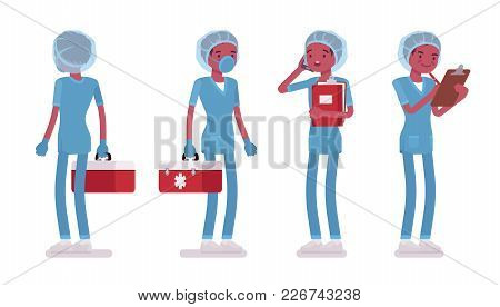 Male Nurse Standing. Young Man In Hospital Uniform At Workplace, Care-giver With Tool Box, Clipboard