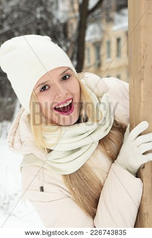 A Young Girl In Light Clothes Enjoys The Winter.