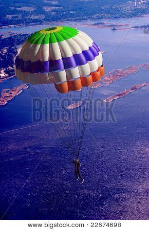Parachutist against the background of natural landscape
