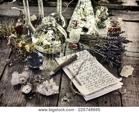 Witch Manuscript With Pencil, Magic Bottles, Crystals, Old Clock And Lavender Flowers On Planks. Hal