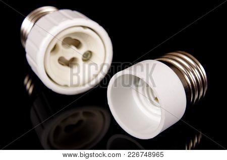 Light Bulb Adapter For E27 Screw On Black Background