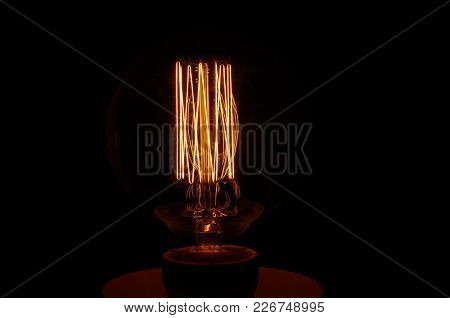 Old Style Lamp Filament Glowing In The Dark