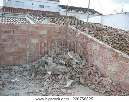 Demolishing Roof Tiles At Village House In Andalusia To Create A Sun Terrace