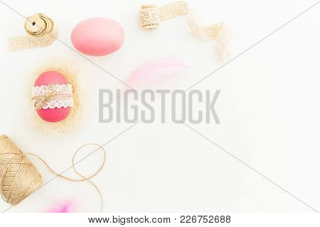 Frame Of Easter Pink Eggs With Twine, Feathers And Tapes On White Background, Top View, Fat Lay. Eas